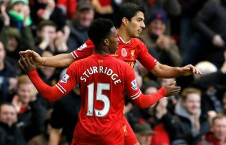 Luis Suarez celebrating with Sturridge